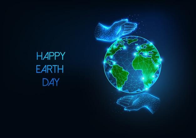 Banner web felice giornata della terra con futuristico incandescente basso pianeta poligonale e premuroso mani umane Vettore Premium