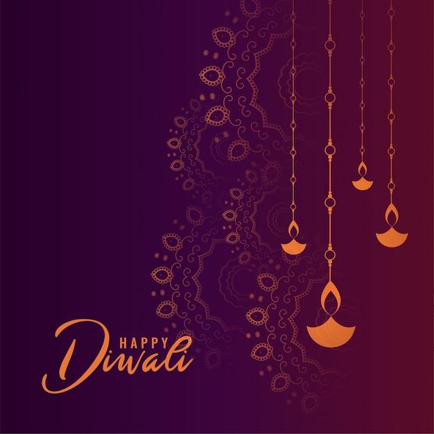 Bella carta viola felice diwali festival Vettore gratuito