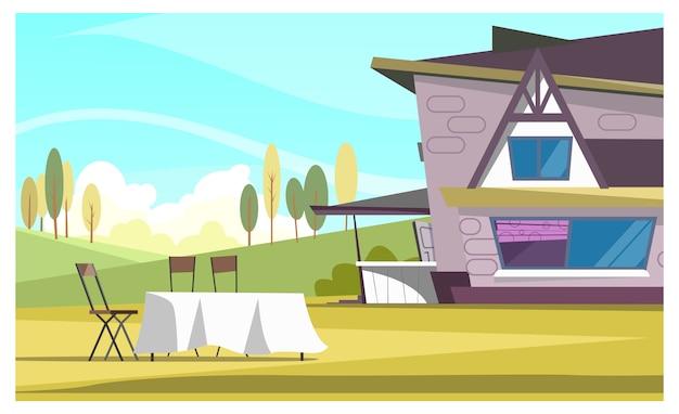 Bella casa e tavola rotonda con panno all'aperto Vettore gratuito