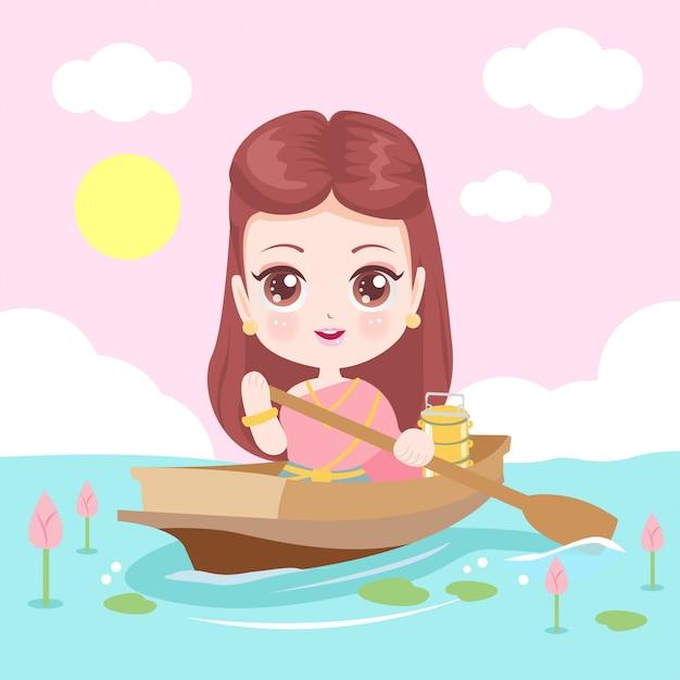 Bella donna tailandese che rema in un canale Vettore Premium