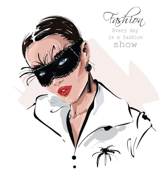 Bella giovane donna disegnata a mano nella maschera nera di carnevale con le piume. ragazza alla moda. look da donna alla moda. Vettore Premium