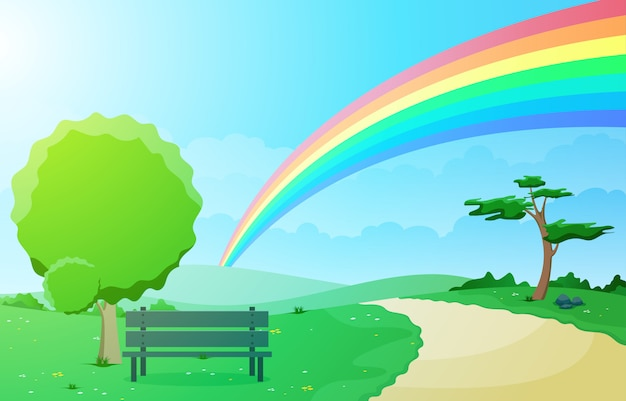 Bello cielo dell'arcobaleno con la natura verde della montagna del prato Vettore Premium