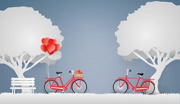 Bicicletta rossa e cuore nel cestino sotto l'albero. Vettore Premium