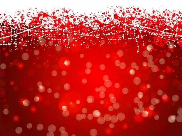 Sfondo rosso con fiocchi di neve