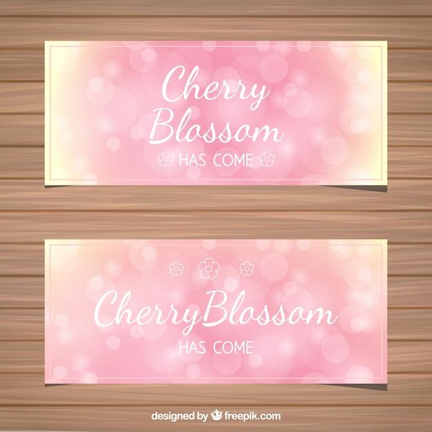 Bokeh striscioni fiore di ciliegio in toni rosa Vettore gratuito