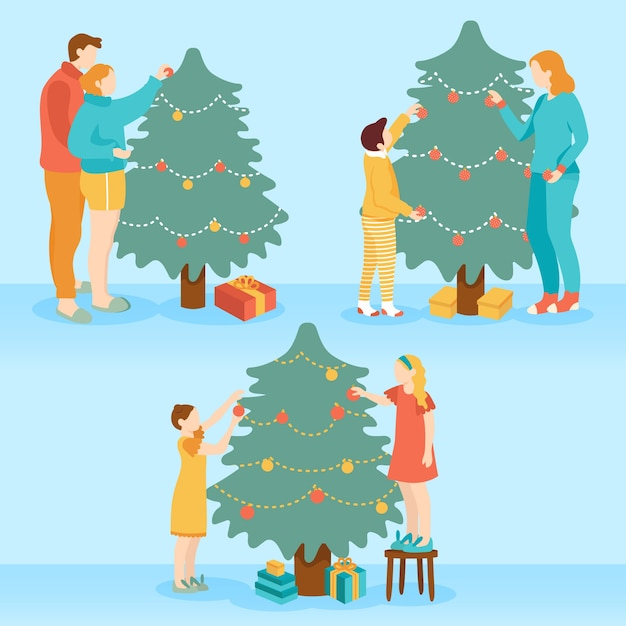 Branco di persone che decorano l'albero di natale Vettore gratuito