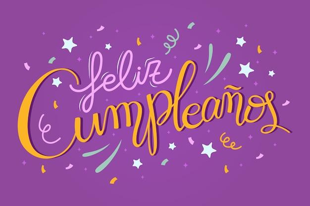 Buon compleanno in caratteri spagnoli con fuochi d'artificio Vettore gratuito