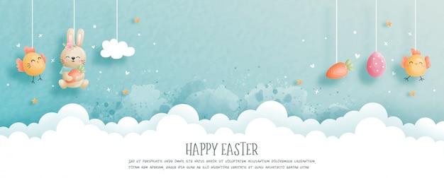Buona pasqua con il coniglietto e le uova di pasqua svegli nell'illustrazione di stile del taglio della carta. Vettore Premium