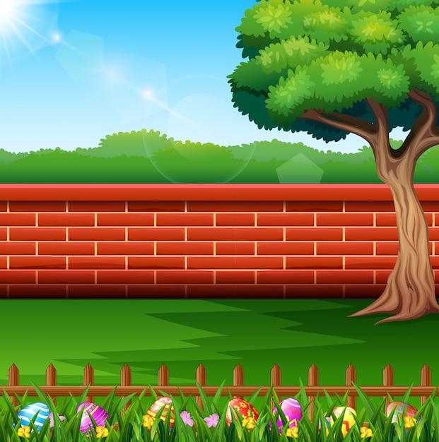 Buona pasqua sulla natura con uno sfondo di recinzione di mattoni Vettore Premium