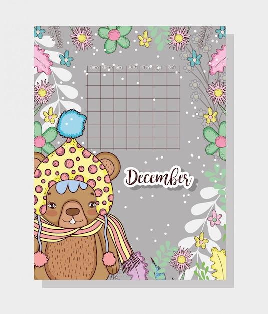 Calendario di dicembre con simpatico orso Vettore Premium