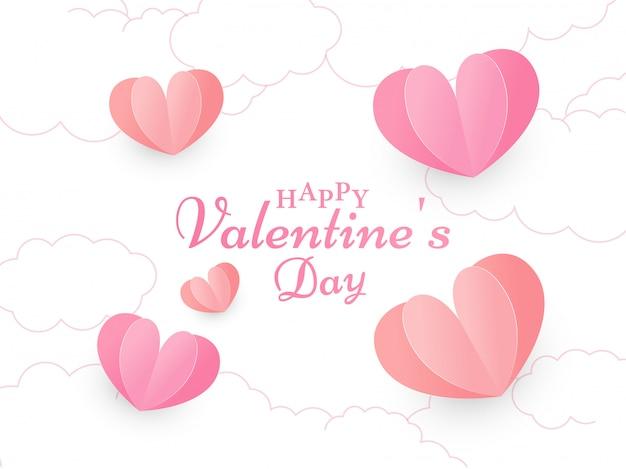 Calligrafia buon san valentino testo su nuvola bianca decorata con cuori rossi e rosa tagliati di carta. Vettore Premium