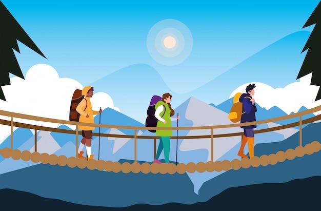 Camper in uno splendido scenario con ponte sospeso Vettore Premium