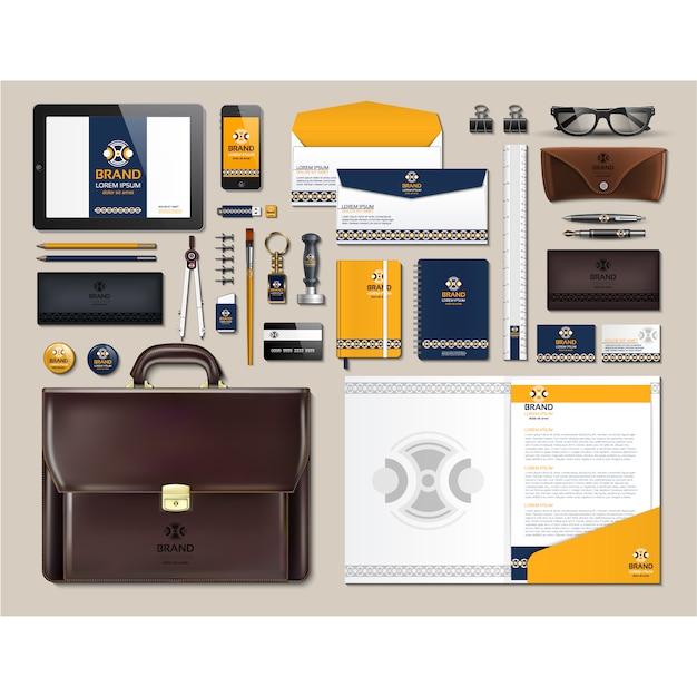 Cancelleria d'affari con disegno giallo Vettore gratuito