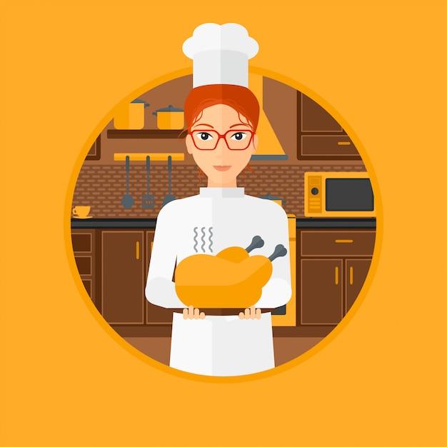 Capo cuoco in possesso di pollo arrosto. Vettore Premium