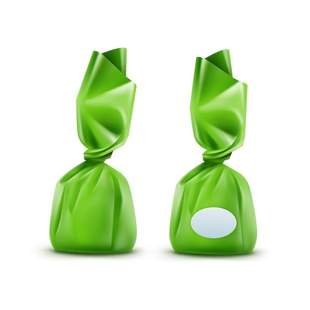 Caramella di cioccolato realistica in involucro lucido verde close up isolati su sfondo bianco Vettore Premium