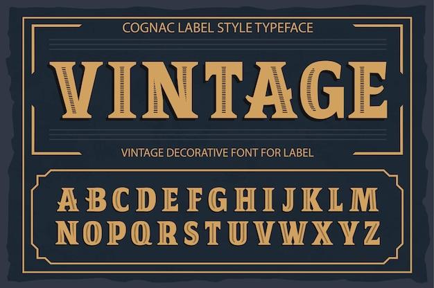 Carattere etichetta vintage, stile etichetta cognac. Vettore Premium