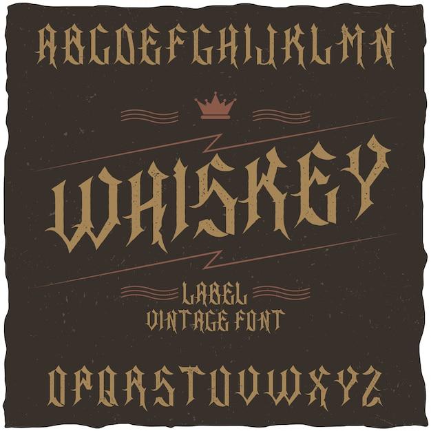Carattere tipografico etichetta vintage denominato whisky. buon carattere da utilizzare in qualsiasi etichetta o logo vintage. Vettore gratuito