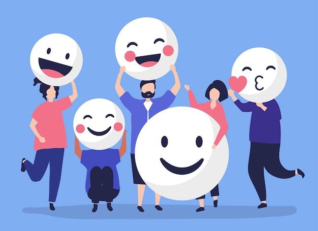 Caratteri della gente che tiene l'illustrazione positiva degli emoticon Vettore gratuito