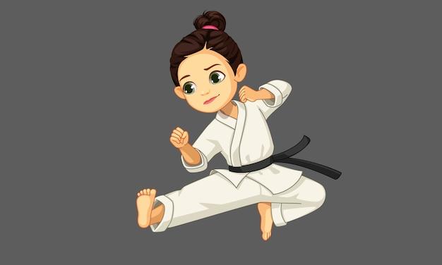 Carina piccola ragazza di karate nel karate Vettore Premium