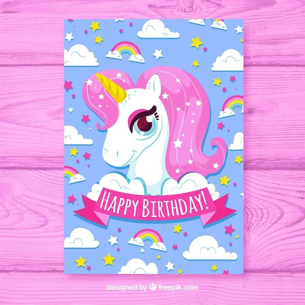 Carta birhtday con stile disegnato unicorno in mano Vettore gratuito
