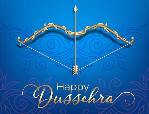 Carta blu festival felice dussehra con fiocco oro e freccia modellata e cristalli su sfondo di colore di carta. Vettore Premium