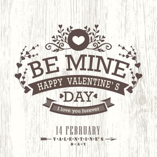 Carta del giorno di San Valentino con floreale annata bandiera del segno su fondo in legno Vettore gratuito