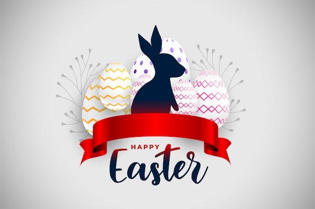 Carta felice di festival di pasqua con il nastro e il coniglio rossi Vettore gratuito