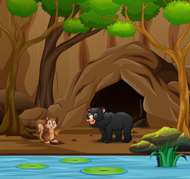 Cartone animato di animali selvatici che vivono nella grotta Vettore Premium