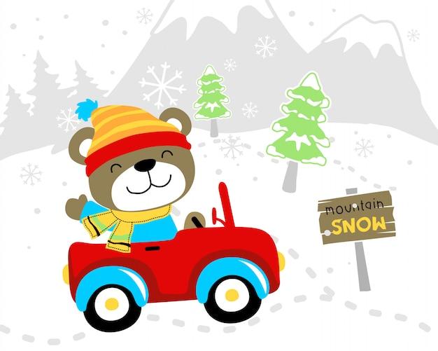 Cartone animato divertente orso in auto in inverno Vettore Premium