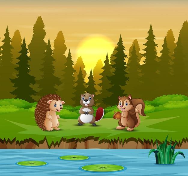 Cartone animato molti animali sul fiume Vettore Premium