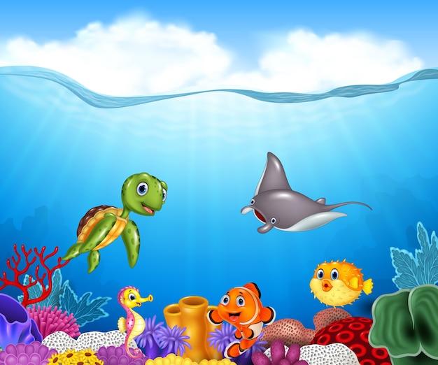 Cartone animato pesci tropicali con un bellissimo mondo sottomarino Vettore Premium