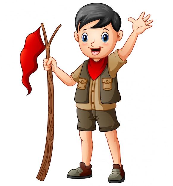 Cartone animato un ragazzo scout che tiene bandiera rossa Vettore Premium