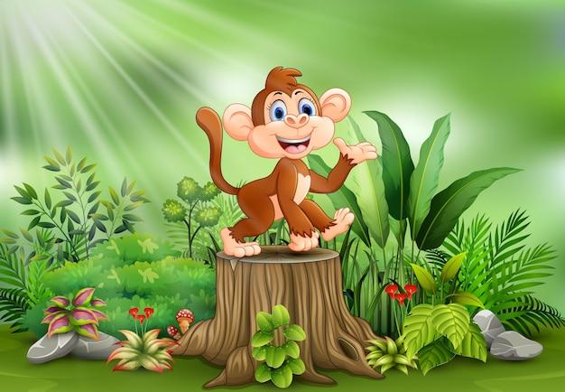 Cartone animato una scimmia che si siede sul ceppo di albero con