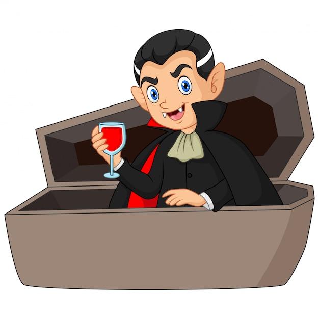 Cartoon dracula beve sangue nella bara Vettore Premium