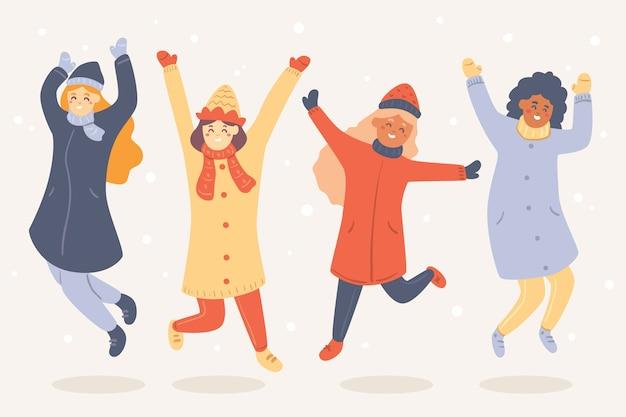 Cartoon indossando abiti invernali e saltare in aria Vettore gratuito
