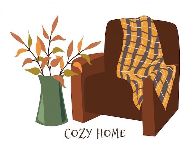 Casa accogliente. poltrona con plaid e rami in vaso Vettore Premium