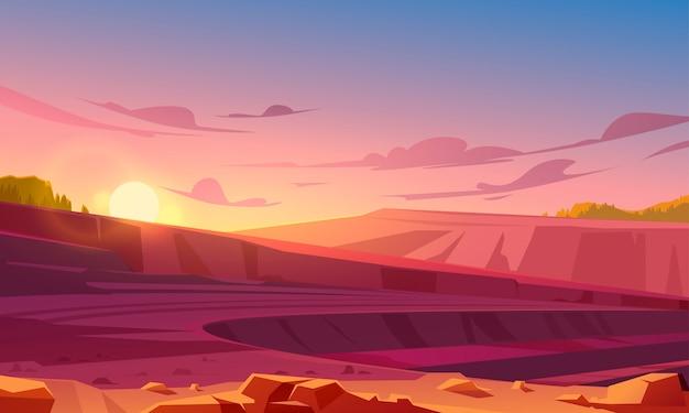 Cava di estrazione a cielo aperto al tramonto Vettore gratuito