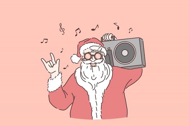 Celebrazione delle vacanze invernali. elegante babbo natale con boombox sulla spalla, santa ascoltando musica, mostrando il gesto rock n roll, capodanno e festa di natale. appartamento semplice Vettore Premium