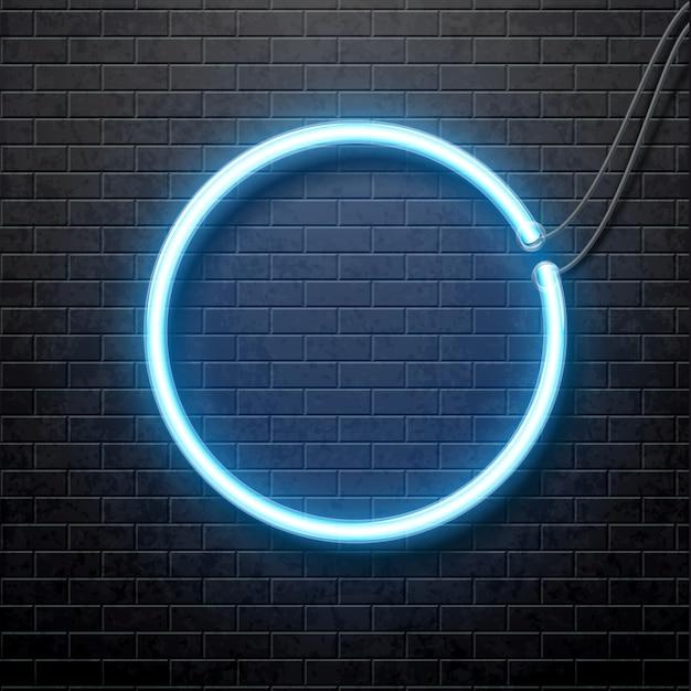 Cerchio blu al neon isolato sul muro di mattoni nero Vettore Premium