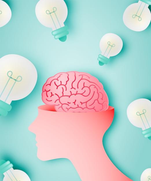 Cervello con il concetto di idea in stile arte carta Vettore Premium