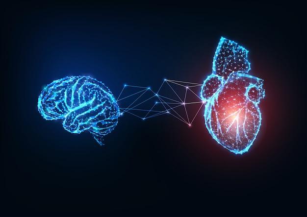 Cervello e cuore collegati poligonali bassi incandescenti futuristici degli organi su fondo blu scuro. Vettore Premium
