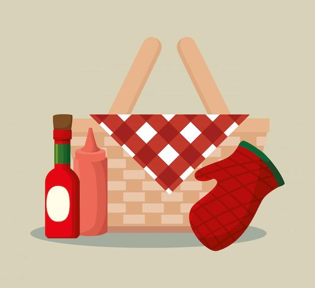 Cestino di vimini barbecue con bottiglie e guanti Vettore gratuito