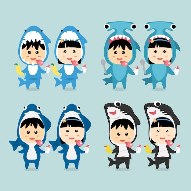 Character design cute kids indossando set costume di squalo. Vettore Premium