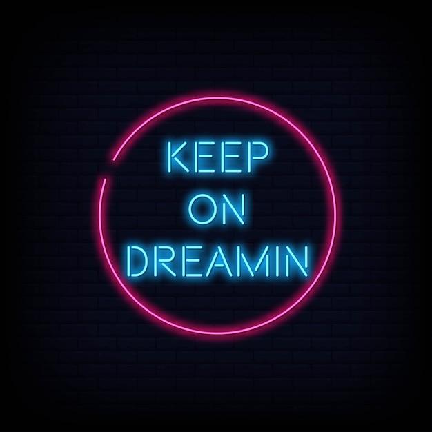 Citazione moderna keep on dreamin neon sign text Vettore Premium