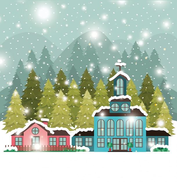 Città con chiesa in snowscape Vettore gratuito