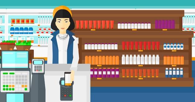 Cliente che paga con il suo smartphone tramite terminale. Vettore Premium