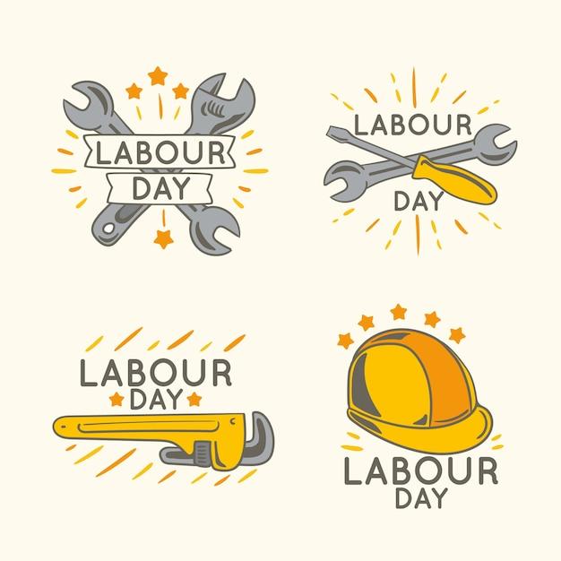 Collezione di badge festa del lavoro disegnati a mano Vettore gratuito