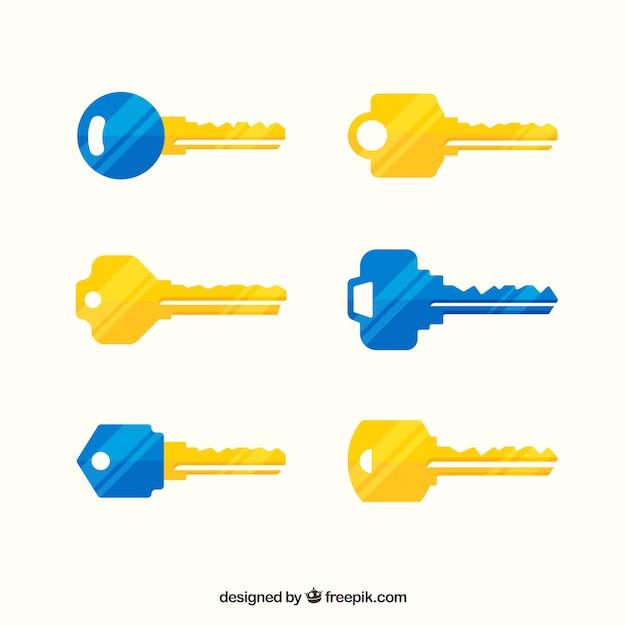 Collezione di chiavi gialla e blu Vettore gratuito
