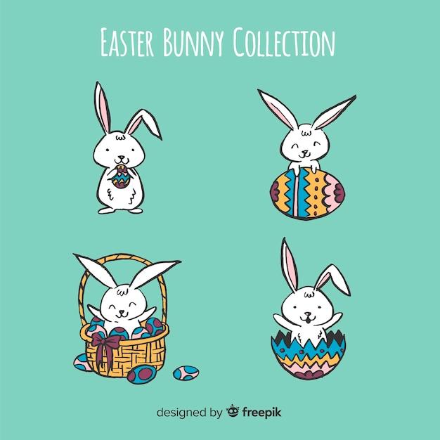 Collezione di coniglietti pasquali dei cartoni animati Vettore gratuito