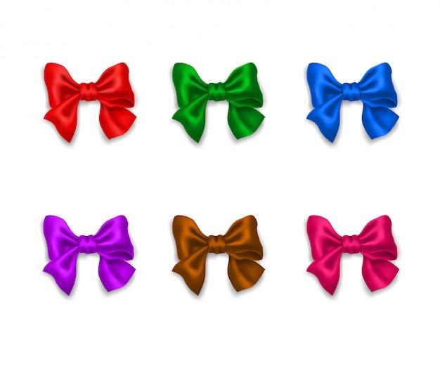 Collezione di fiocchi di nastro lucido multicolore decorativi realistici. Vettore Premium